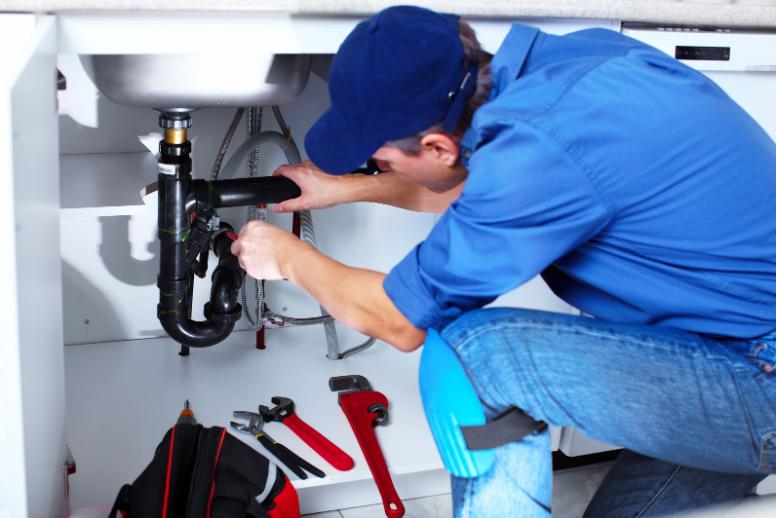 Professional plumber doing a residential repair
