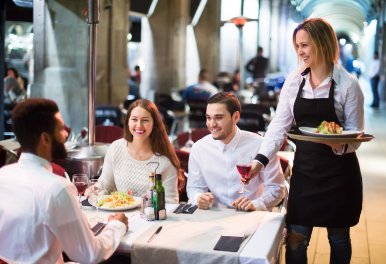 A waitress walks over to serve the restaurant's customers