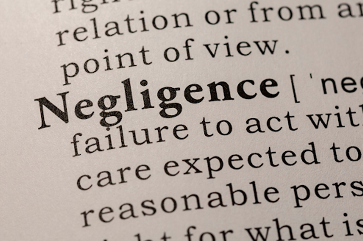 Close up of the definition of negligence