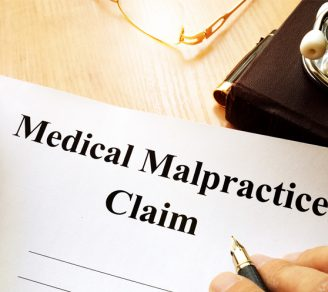 """Paper with the words """"Medical Malpractice Claim"""" on it"""