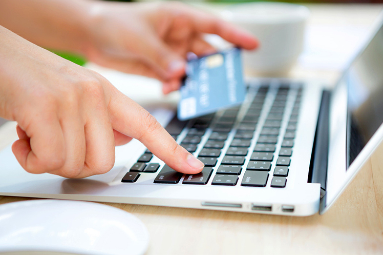 Customer using a credit card for an online purchase