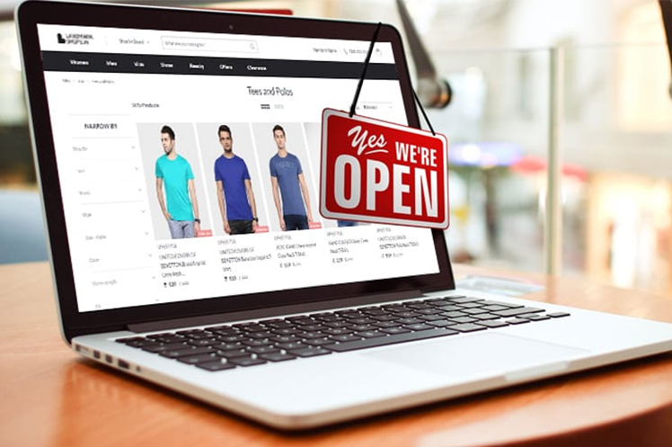 Online store showing on a laptop screen with a signage on it