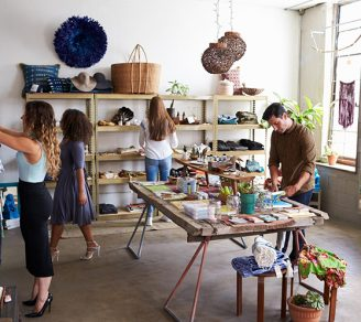 A photo of a boutique with shoppers looking around