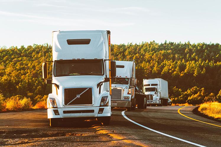 Three cargo trucks delivering shipments