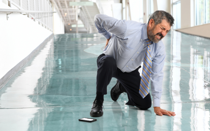 A man slips and falls at work