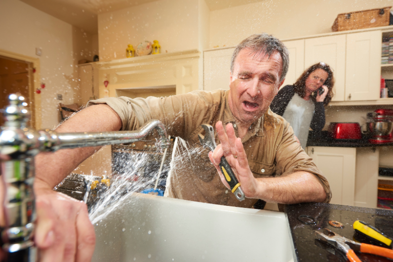A plumber causing water damage to a client's home