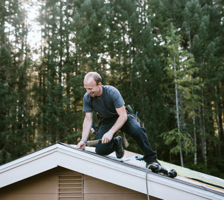 A roofing contractor installing tiles on a rooftop