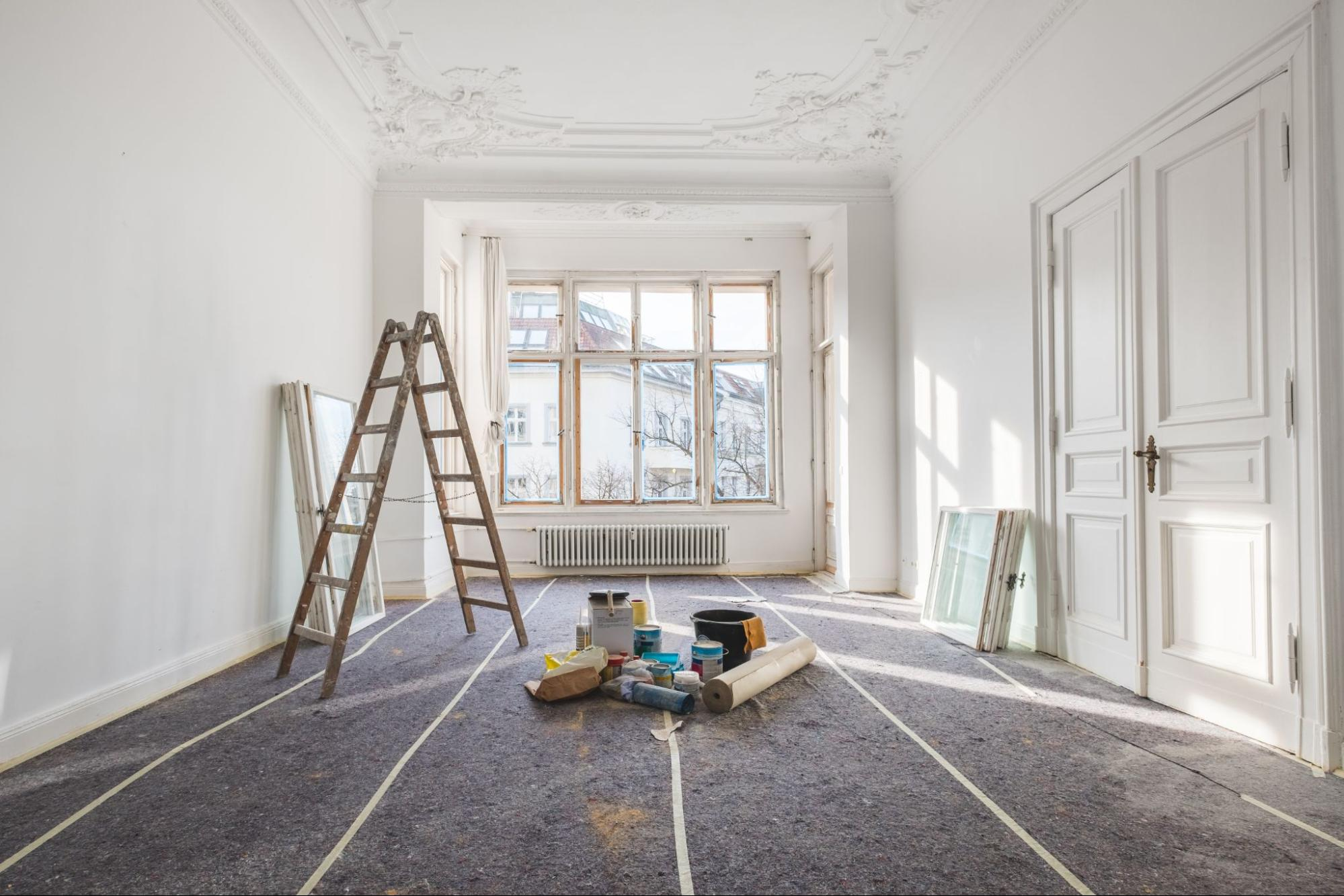 An empty room with renovation materials in the middle