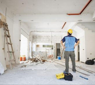 A home renovation contractor looking at a room to be renovated