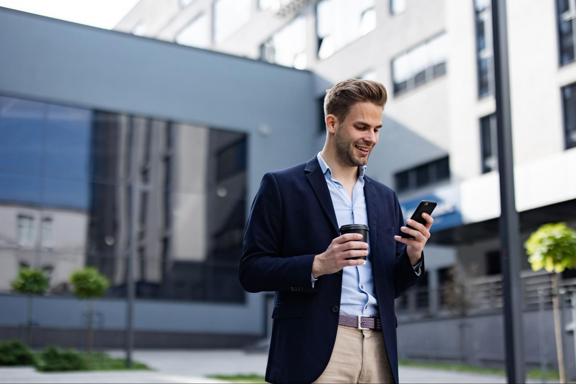 A business owner using a phone for paying his premium