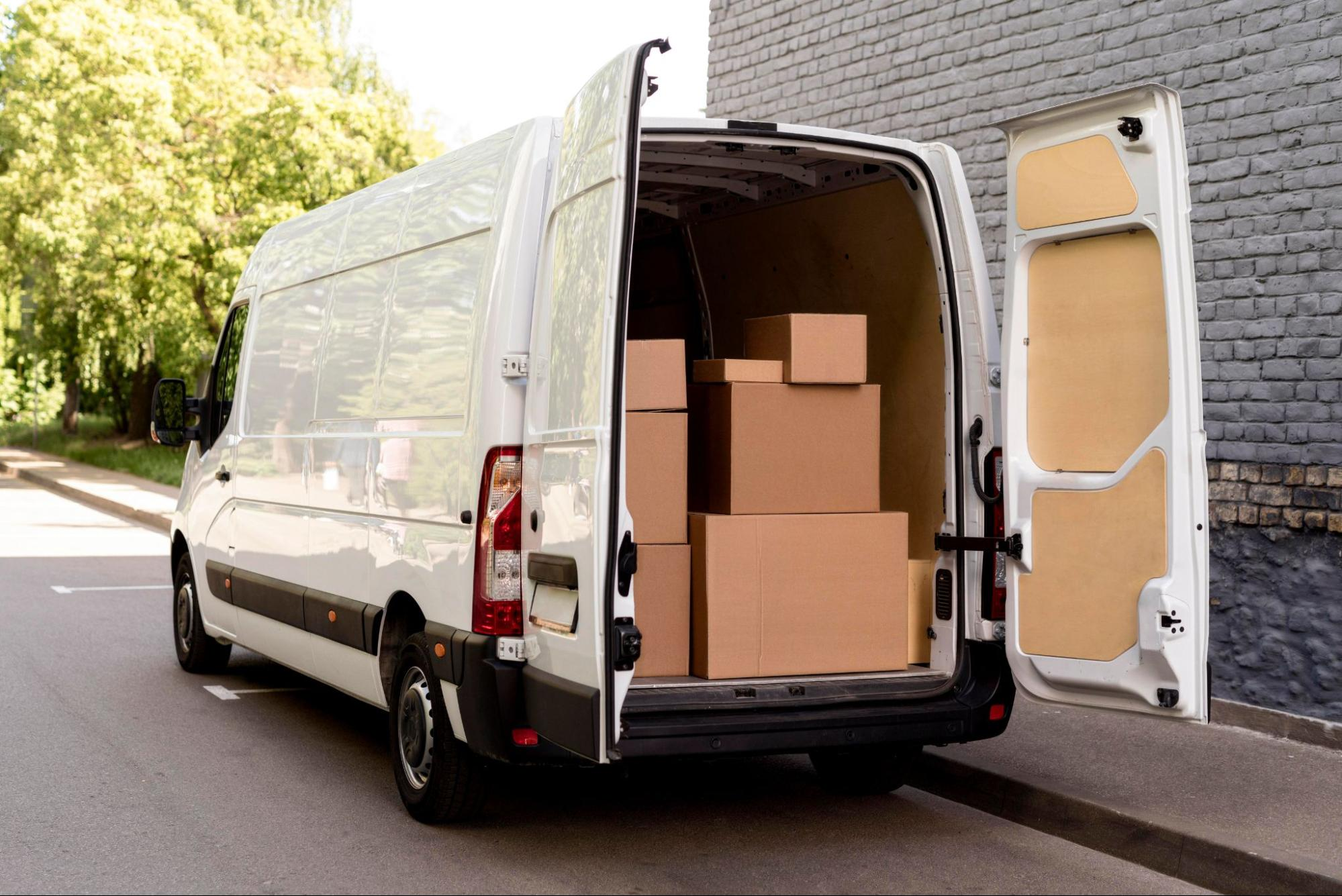 A delivery van with the backdoor open to show boxes inside