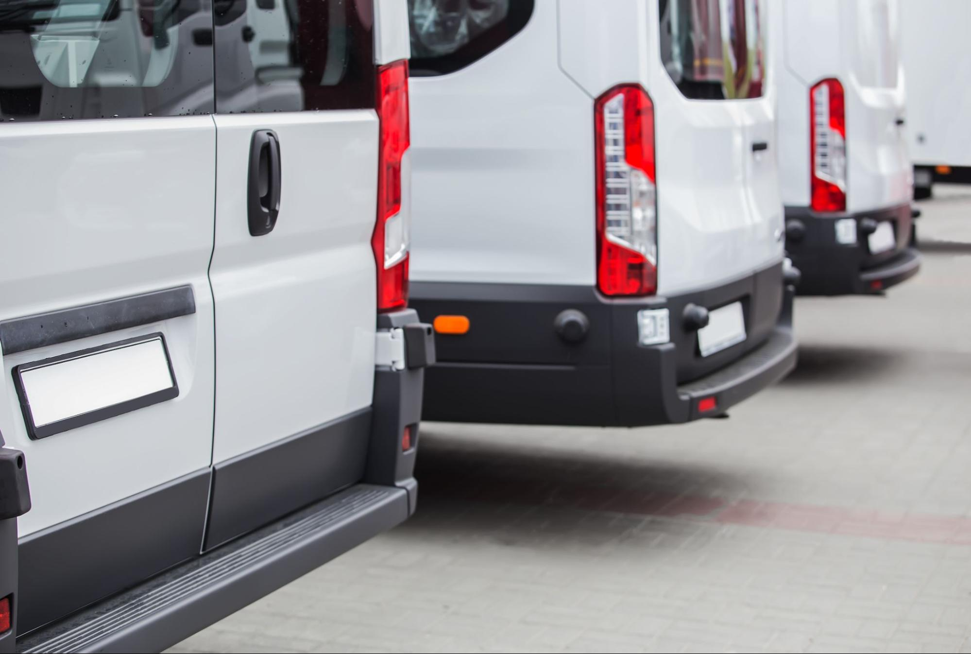 The back part of a parked fleet of commercial vehicles