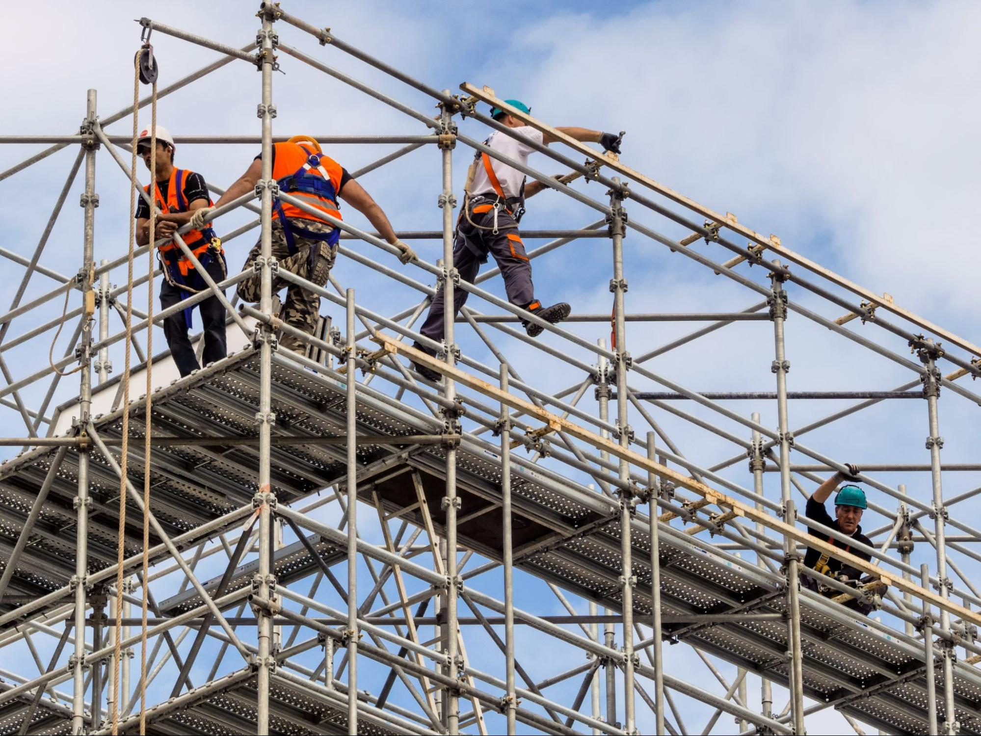 Employees high up on a scaffold
