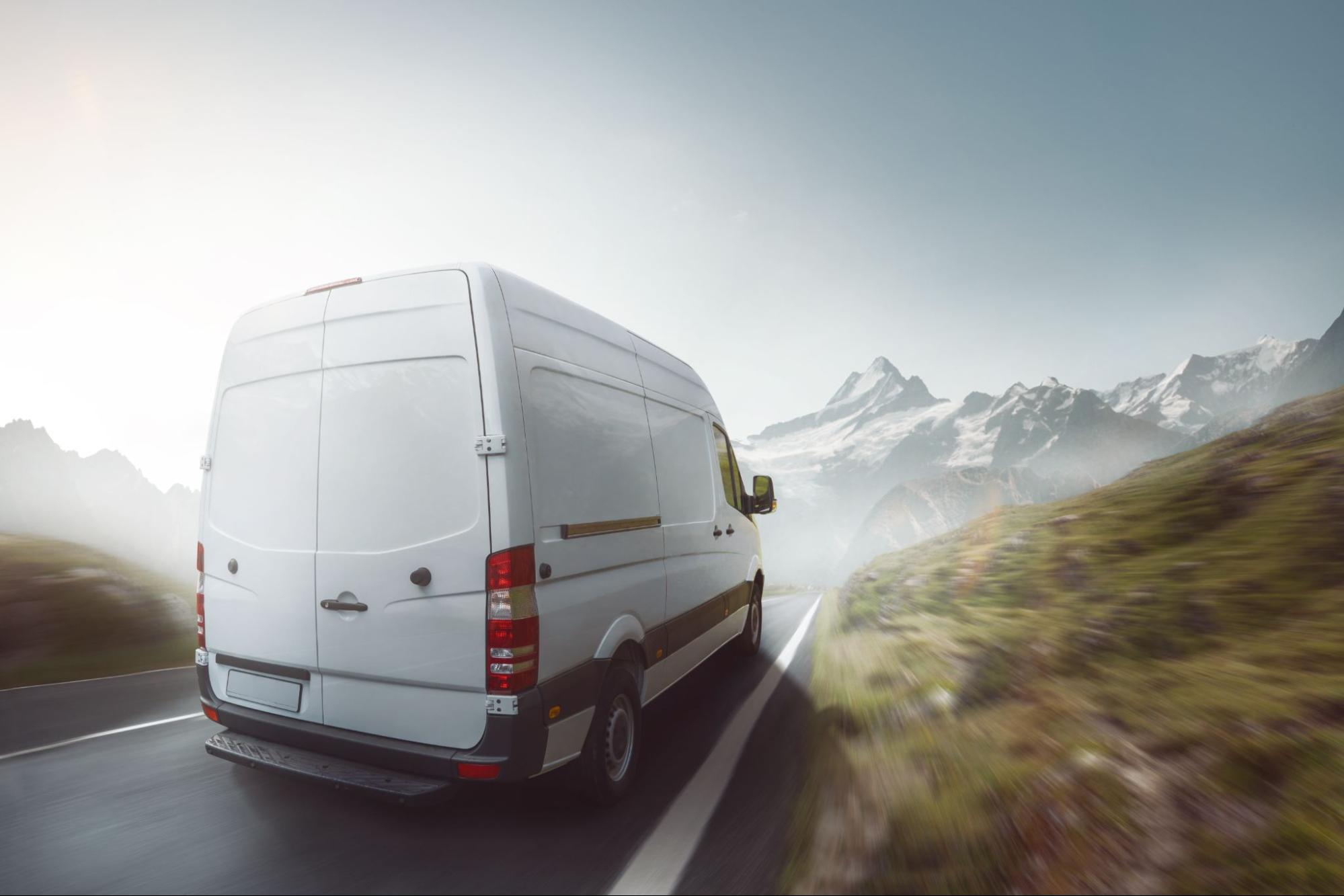 A commercial vehicle driving into a foggy road
