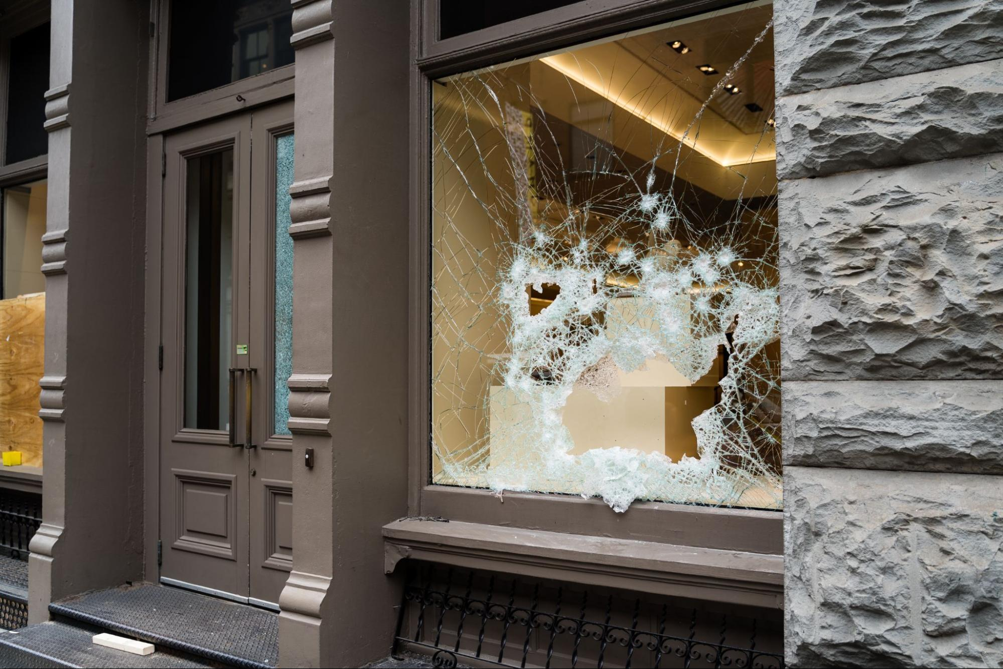 Broken windows caused by vandalism, a common landlord insurance claim
