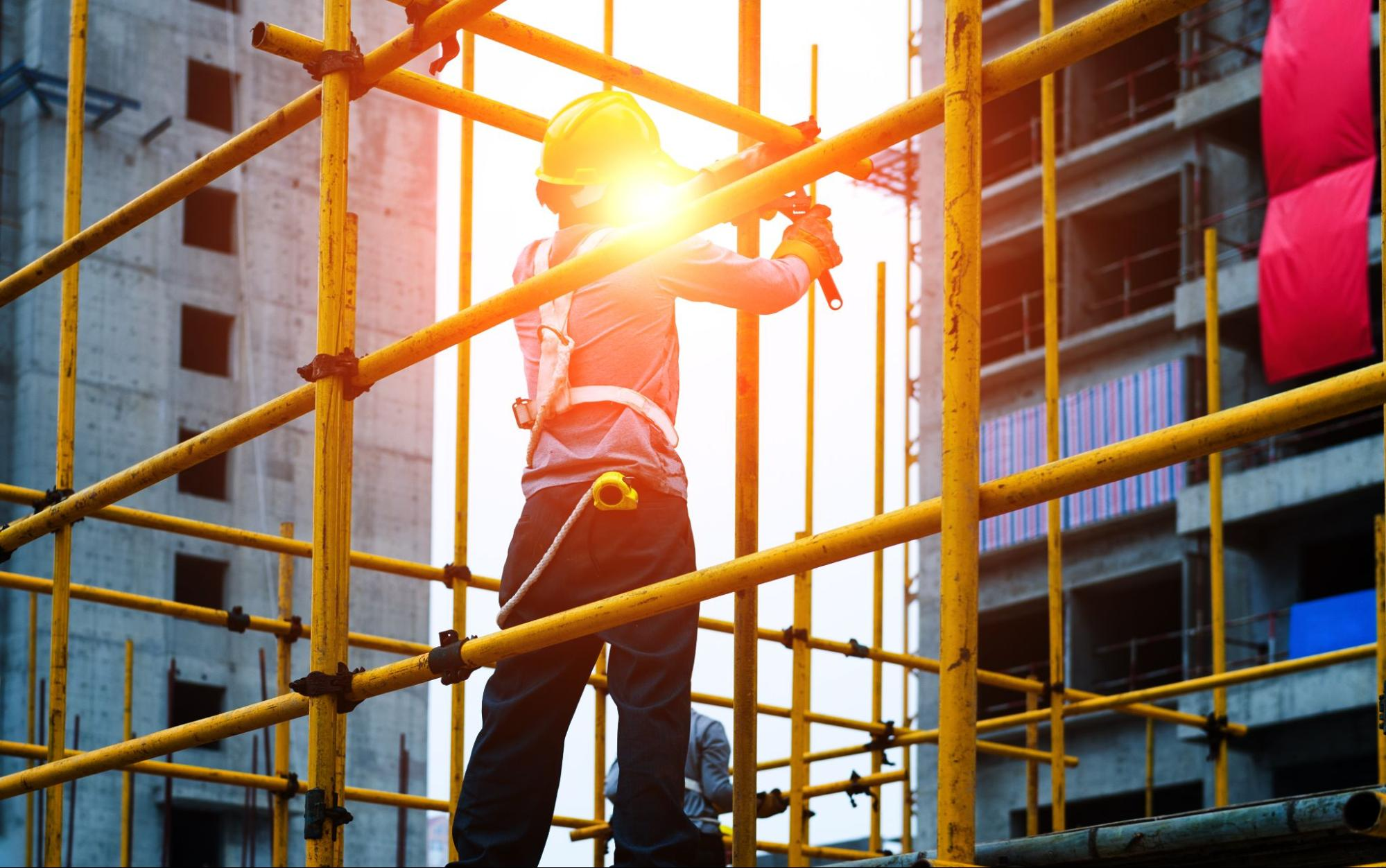An employee of a scaffolding company, setting up scaffolding