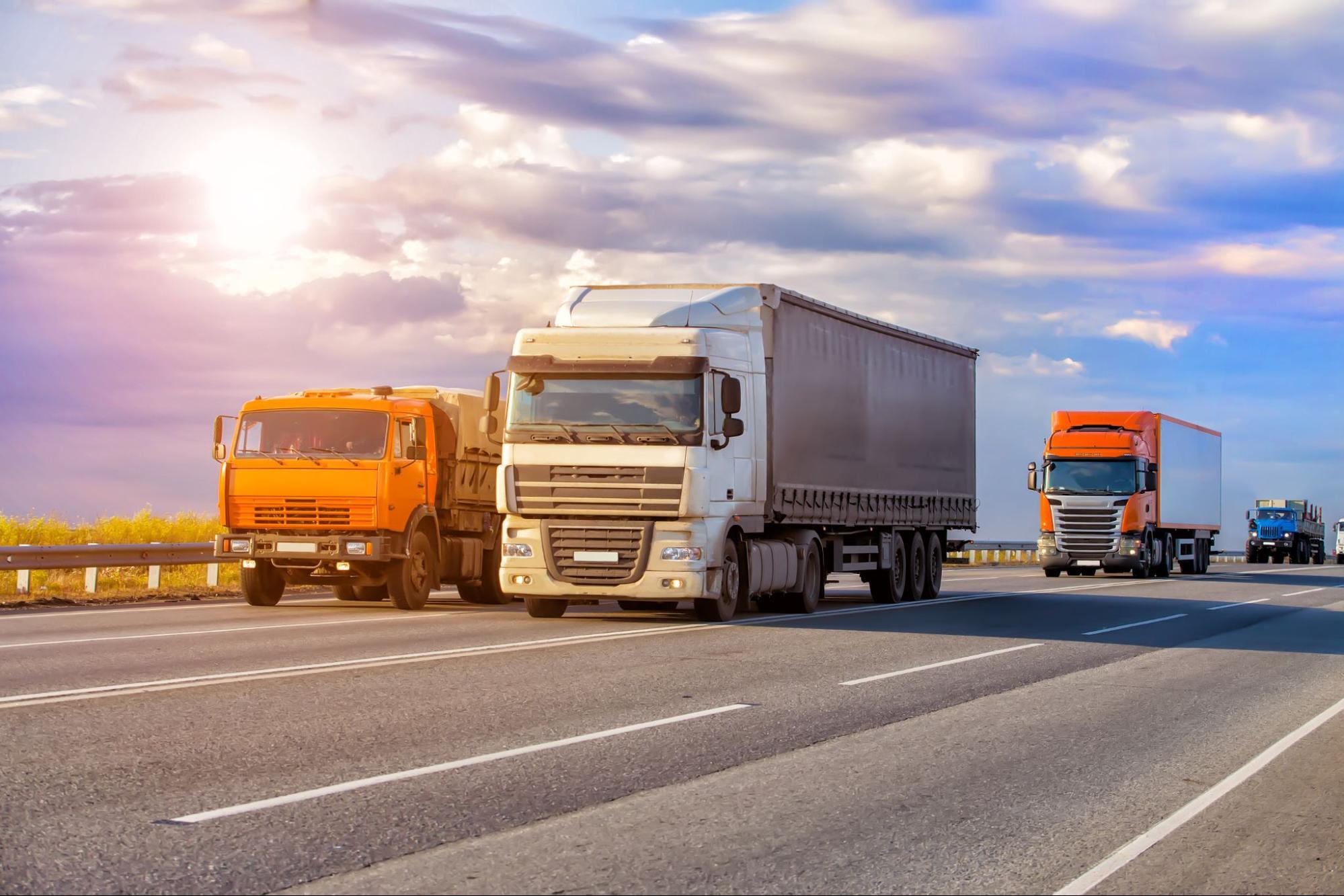 Fleet of commercial trucks on the highway