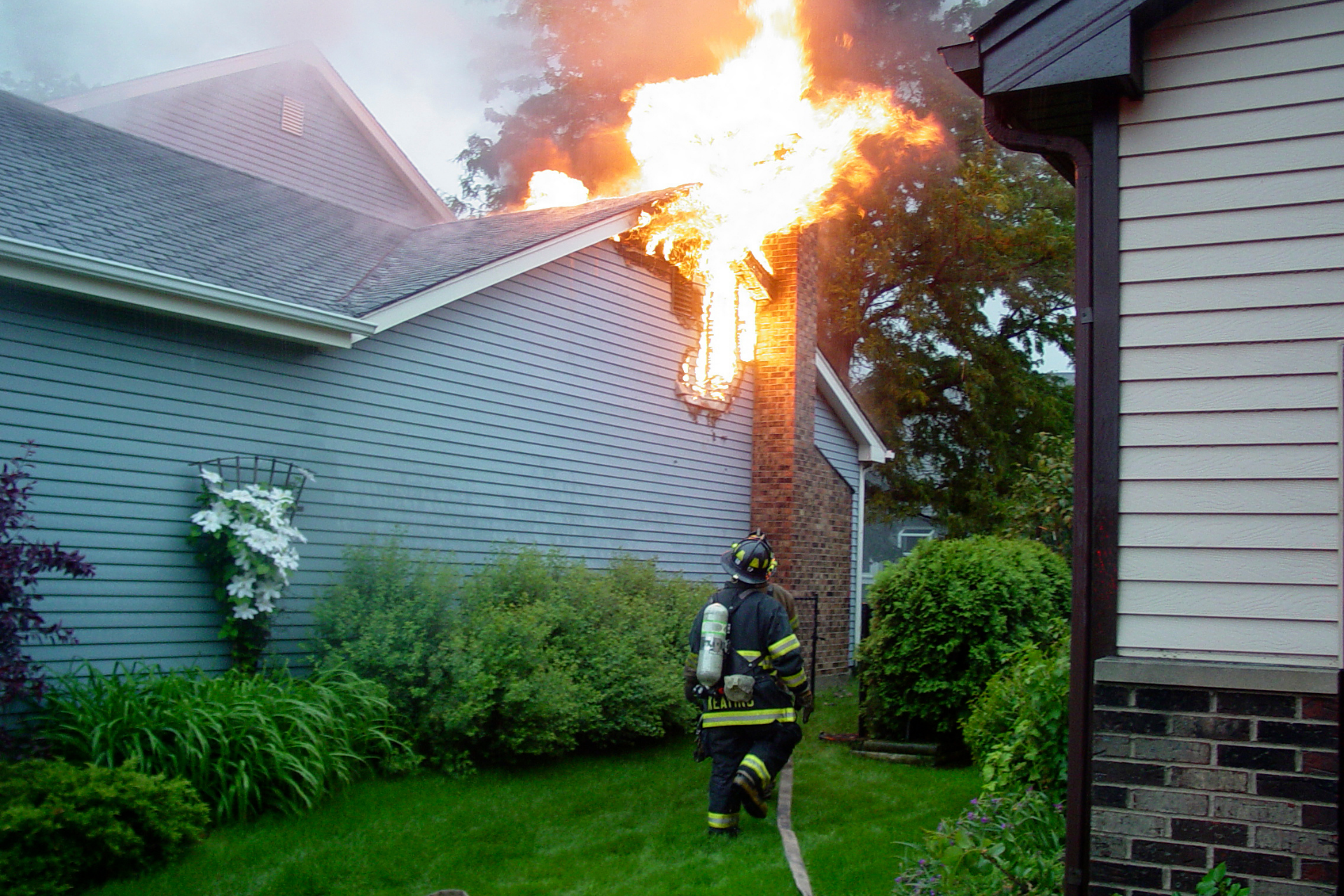 a firefighter fighting a house fire