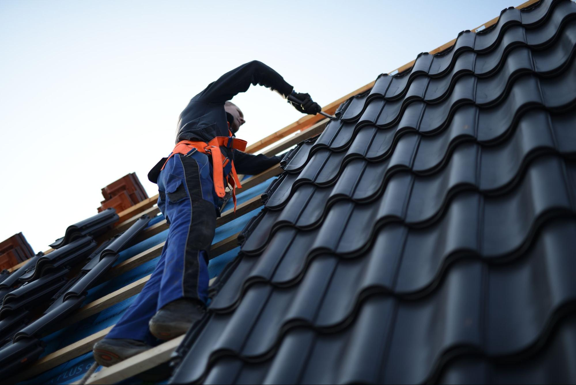 A roofing contractor doing maintenance work on the roof