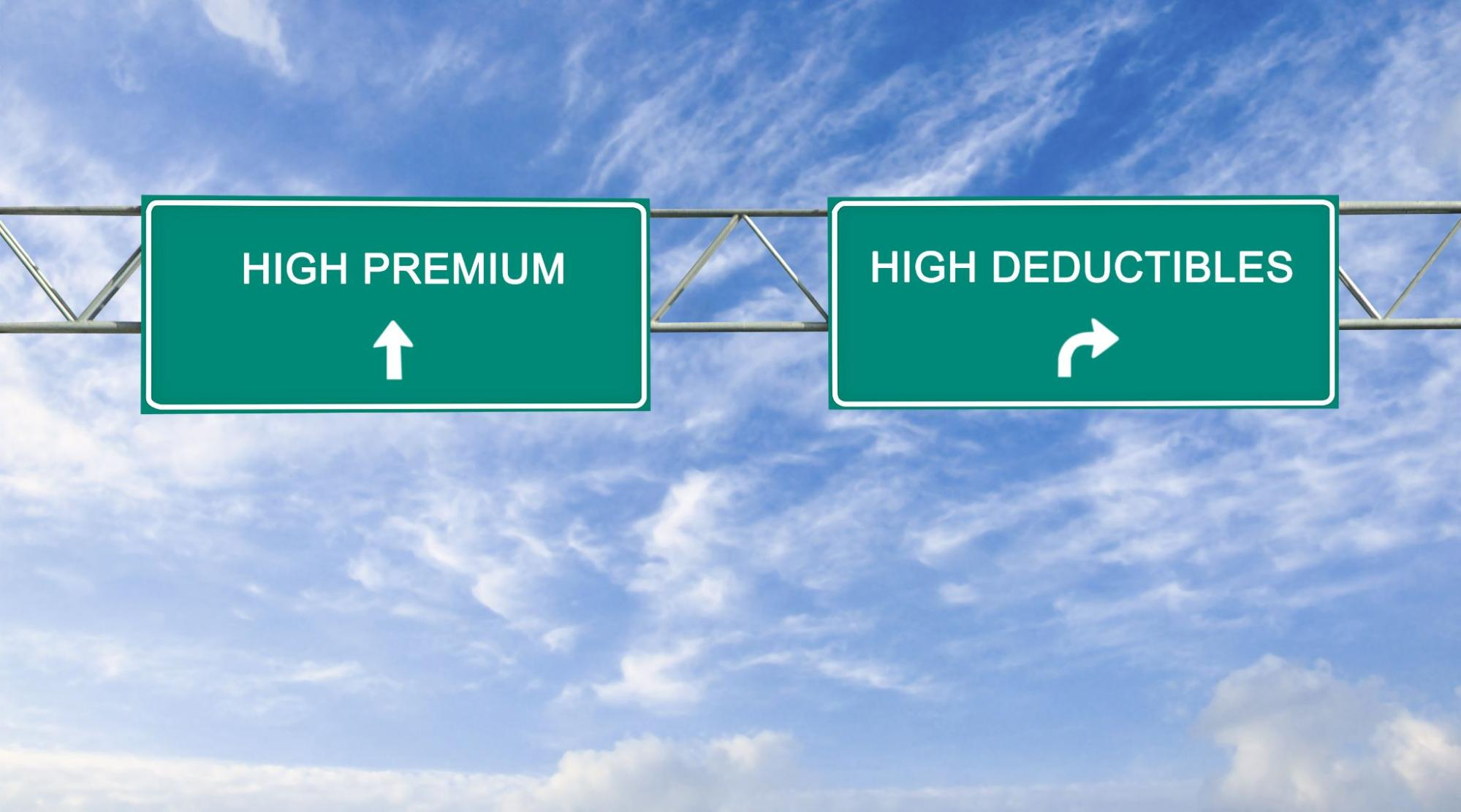 Road signs representing the choice between high deductibles or high premiums