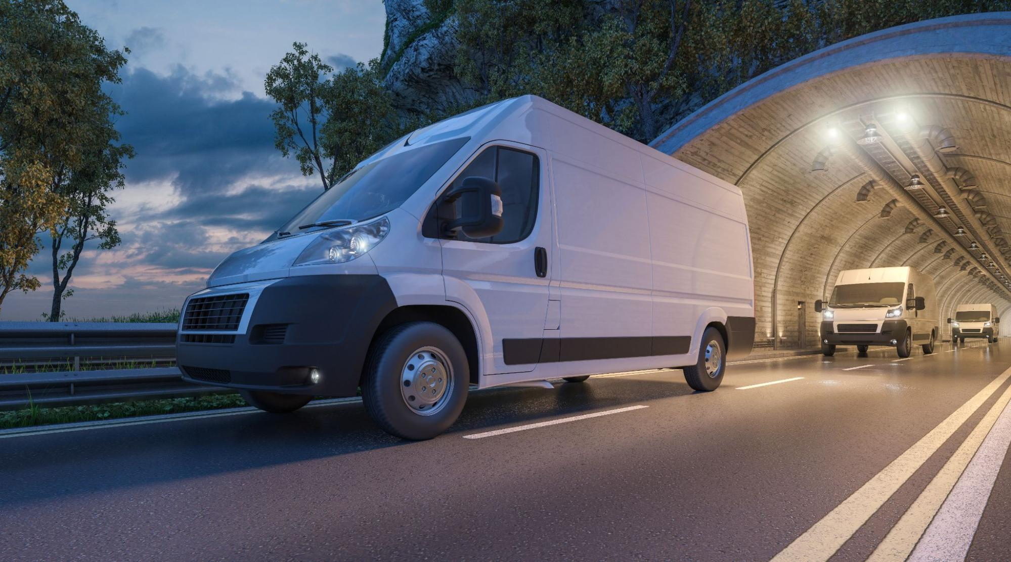 Commercial vans going out of a tunnel