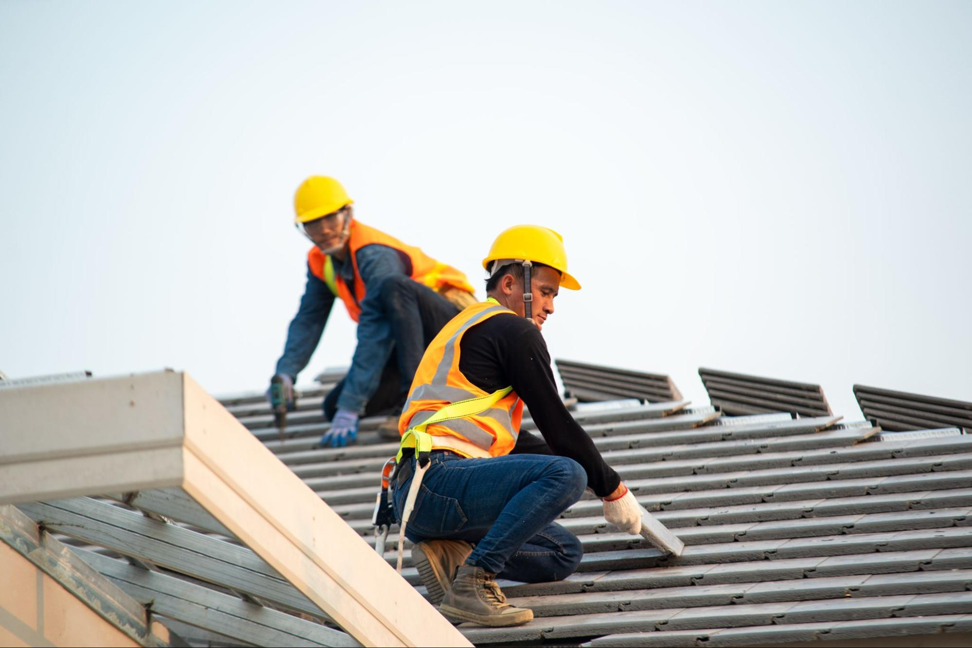 Two roofing contractors at work